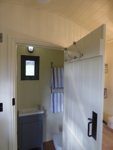 Interior view into the ensuite shower room in one of Stockman's shepherd huts