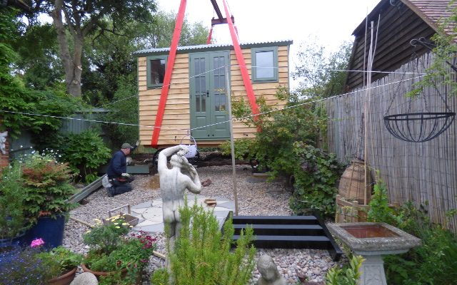 Stockman shepherd hut being craned into small garden