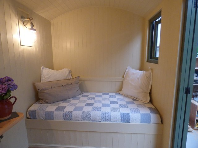 Bed inside a shepherd hut