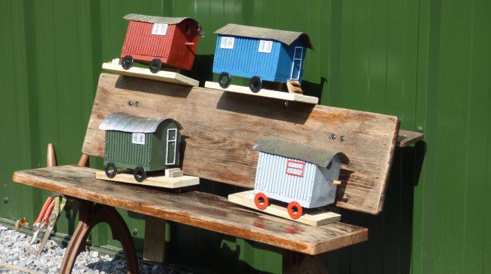Bird houses in the shape of mini shepherd huts
