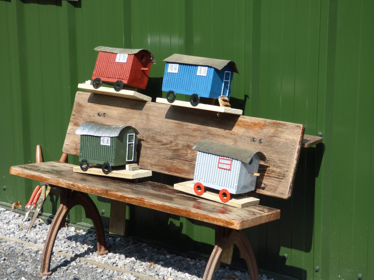 Bird houses in the shape of mini shepherd huts