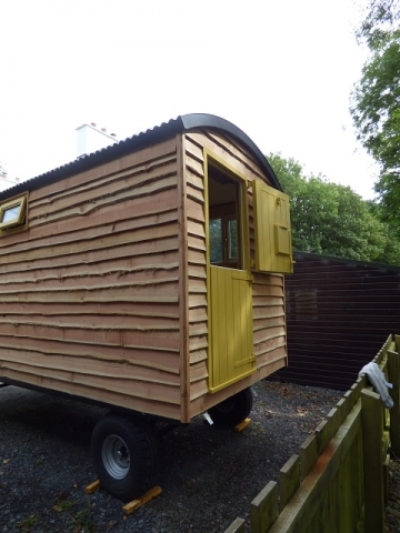 Stockman hut with waney edge cladding