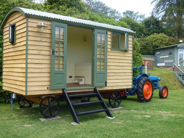 Shepherd Hut Pulled by Old Tractor