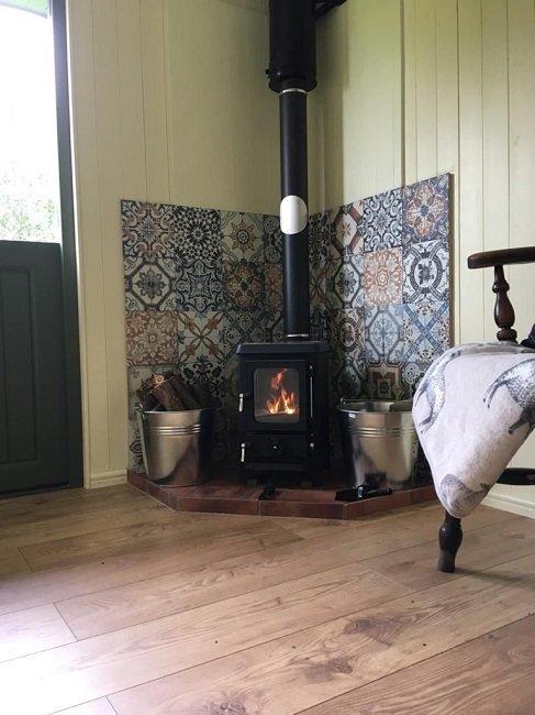 Log burner in bespoke shepherd hut