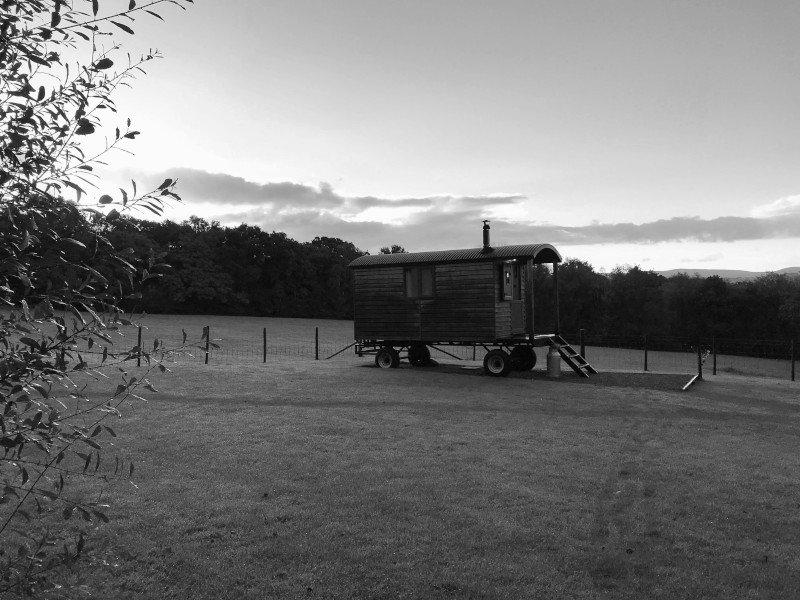 Stockman shepherd's hut on open hillside field site