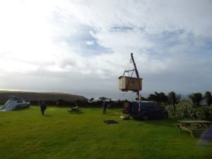 Shepherds Hut being delivered by crane