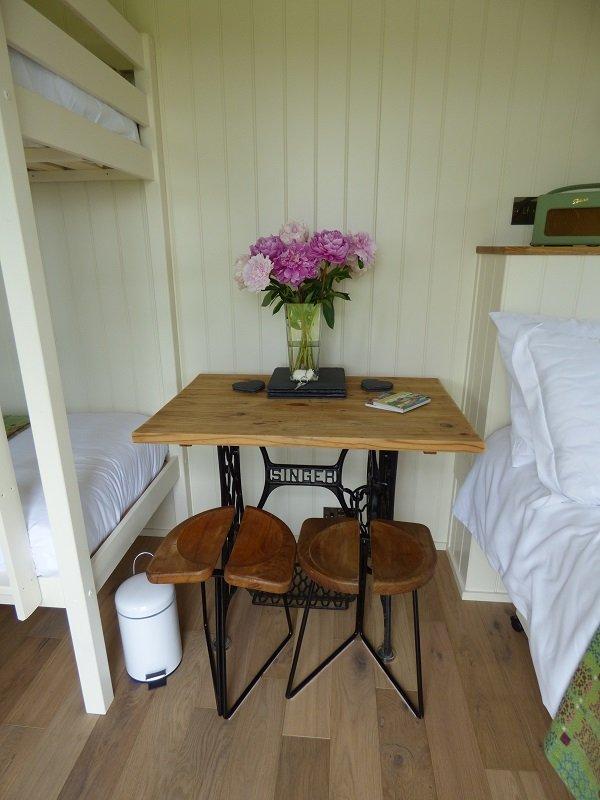 Refurbed Singer table inside handmade, bespoke shepherd's hut