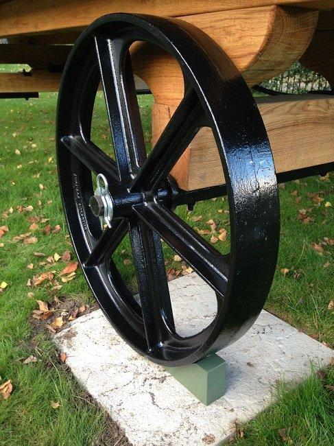 Cast iron wheel on shepherd hut