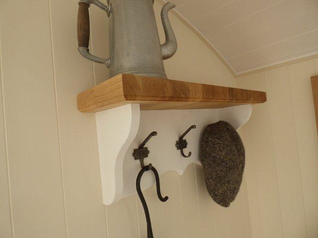 oak shelving with coat hooks